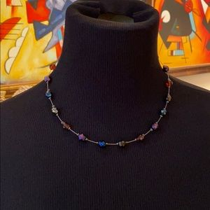 Necklace with jeweled beads.